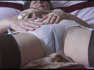 Hairy granny in slip and stockings with see thru panties strips