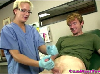 Cum loving nurse watches patient blow