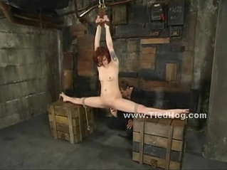 Redhead subdued in bondage rough sex